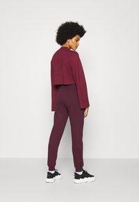 New Look - SLIM LEG JOGGER - Tracksuit bottoms - dark burgundy - 2