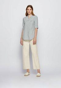 BOSS - BEFELIZE - Button-down blouse - light green - 1