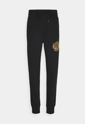 ORGANIC - Tracksuit bottoms - mottled olive