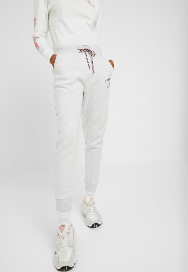 Tommy Jeans - SWEATPANT - Tracksuit bottoms - pale grey
