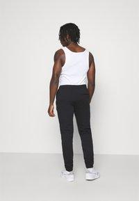 adidas Originals - PANT UNISEX - Tracksuit bottoms - black - 2
