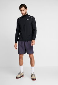 Nike Performance - Sportshirt - black/reflective silver - 1