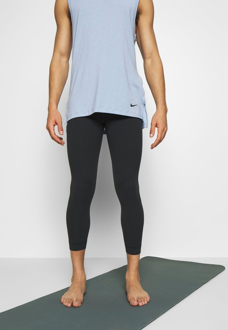 Nike Performance - Leggings - black