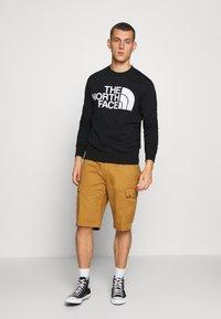 The North Face - STANDARD CREW - Sweatshirt - black - 1
