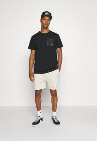 Nike Sportswear - T-shirt - bas - black - 1