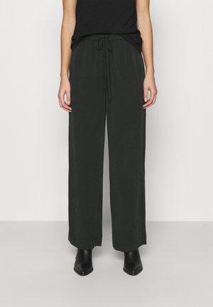 YVETTE - Trousers - black