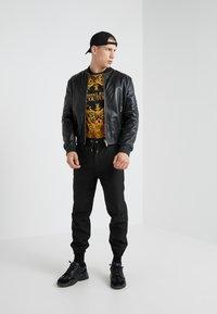 Versace Jeans Couture - GIUBBETTI UOMO - Kožená bunda - nero - 1