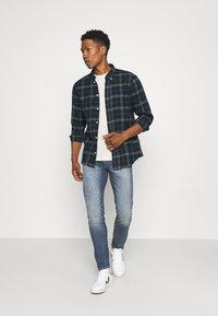 Levi's® - 512™ SLIM TAPER - Slim fit jeans - play everyday - 1