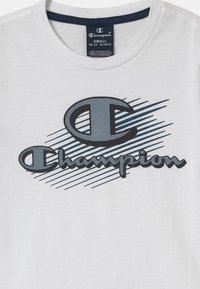 Champion - GRAPHIC SET UNISEX - Print T-shirt - white - 3