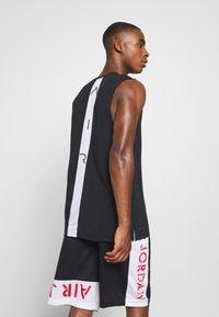 Jordan - AIR TOP - T-shirt de sport - black/white - 2