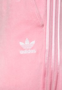 adidas Originals - JOGGER - Tracksuit bottoms - lightpink