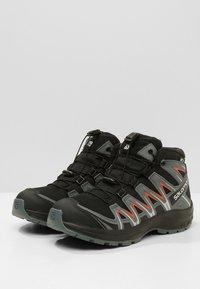 Salomon - XA PRO 3D MID J - Hiking shoes - black/stormy weather/cherry tomato - 3