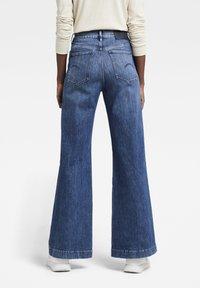 G-Star - DECK ULTRA HIGH WIDE LEG - Flared Jeans - faded santorini - 1