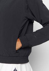 Nike Golf - Softshellová bunda - black - 5