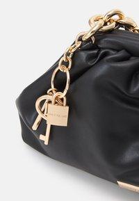 River Island - CHUNKY CHAIN ROUCHED BAG - Handbag - black - 3