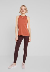Nike Performance - TANK ALL OVER  - Sports shirt - dusty peach/echo pink - 1