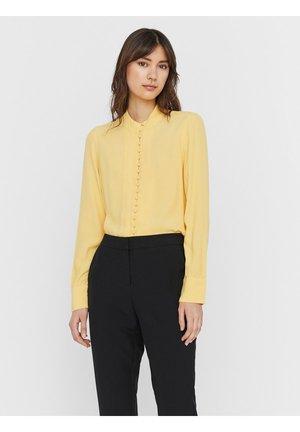 JAPANISCHER - Button-down blouse - cornsilk