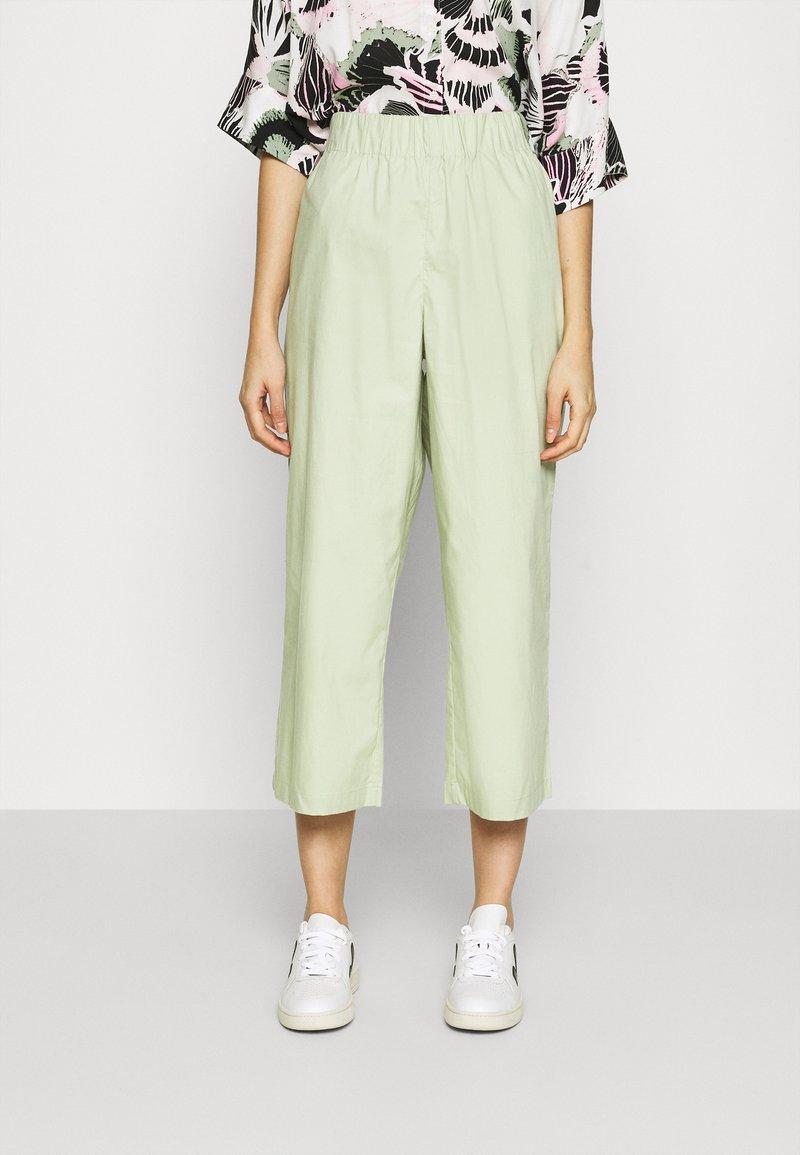 Monki - VILJA TROUSERS - Trousers - green dusty light