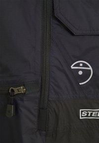 The North Face - STEEP TECH LIGHT RAIN JACKET - Waterproof jacket - black - 6