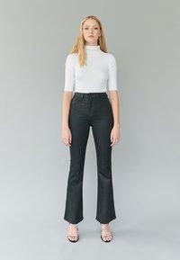 TALLY WEiJL - Trousers - black - 1