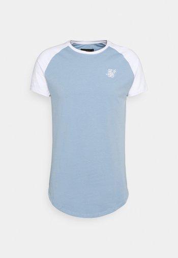 CONTRAST RAGLAN TEE - Basic T-shirt - faded denim/white