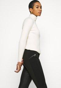 Calvin Klein Jeans - MOTO COATED MILANO  - Leggings - Trousers - black - 3