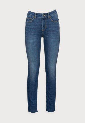 DIVINE - Jeans Skinny Fit - blue tender wash