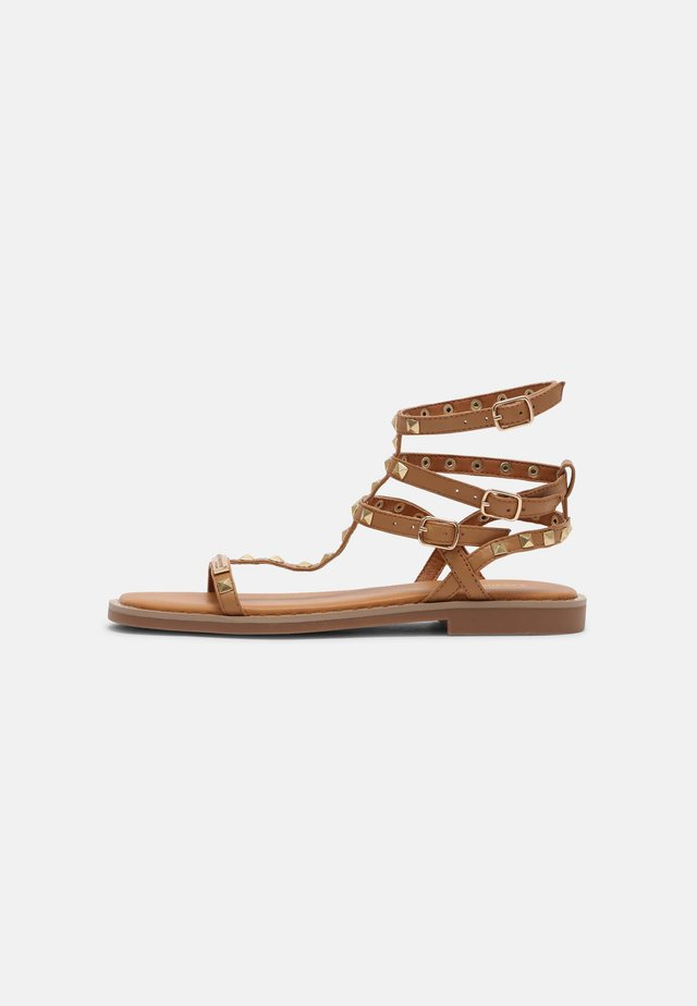 CORALIE - Ankle cuff sandals - tan