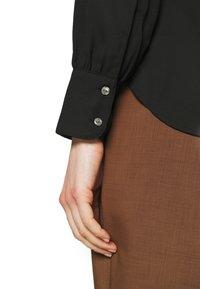 Marks & Spencer London - BLOUSE - Button-down blouse - black - 3