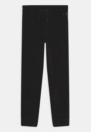 TAPE - Tracksuit bottoms - black