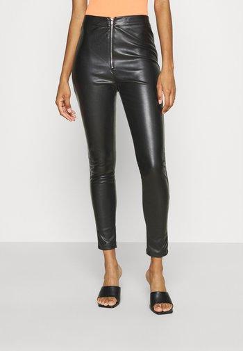 SKAI PANTS - Trousers - black