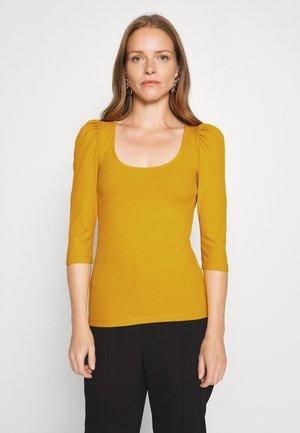 Langærmede T-shirts - golden