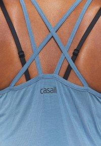 Casall - ATTITUDE STRAP TANK - Top - inclusive blue - 6