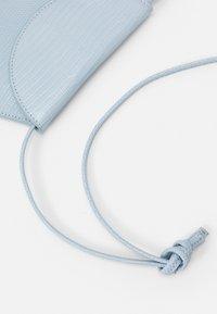 Little Liffner - PEBBLE MICRO BAG - Across body bag - light blue - 4