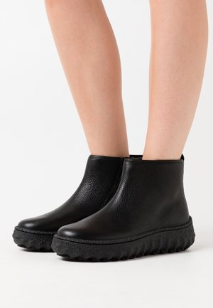 GROUND - Ankle boots - black
