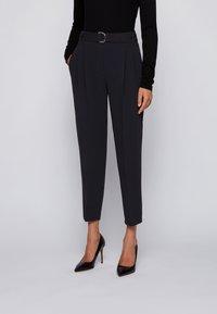 BOSS - TAPIA - Trousers - black - 0
