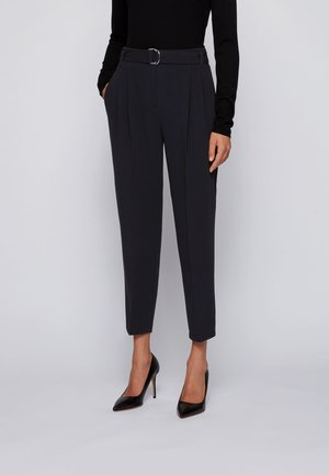 TAPIA - Trousers - black