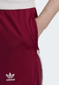 adidas Originals - DANIËLLE CATHARI JOGGERS - Joggebukse - purple - 4