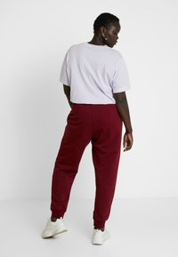 Nike Sportswear - PANT - Tracksuit bottoms - team red/white - 2