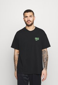 Nike Performance - TEE - Print T-shirt - black - 0