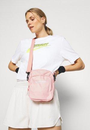 ANA CROSSBODY BAG - Across body bag - pink