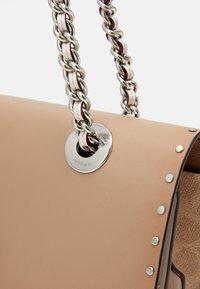 Coach - SIGNATURE BORDER RIVETS PARKER SHOULDER BAG - Handbag - sand/taupe/multi - 3