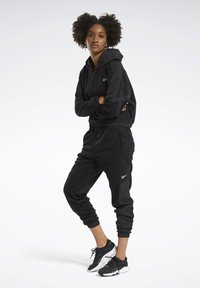 Reebok - MYT WARM-UP JOGGERS - Tracksuit bottoms - black - 1