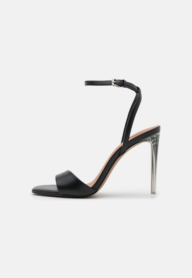 CALISTA - Sandaalit nilkkaremmillä - black