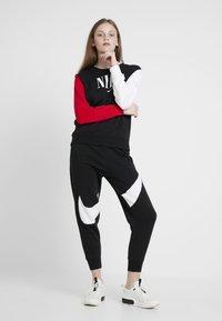 Nike Sportswear - PANT - Jogginghose - black/white - 1
