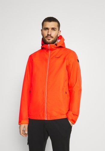 VELDEN - Hardshell jacket - dark orange