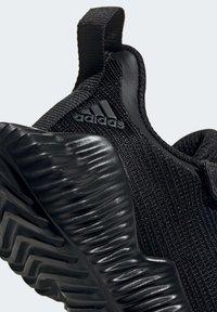 adidas Performance - FORTARUN AC SHOES - Obuwie do biegania Stabilność - black - 6