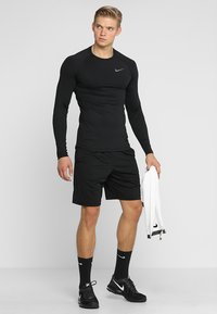 Nike Performance - Sports shirt - black/black/dark grey - 1