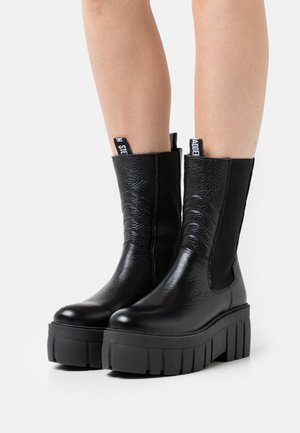 AZZY - Platform ankle boots - black