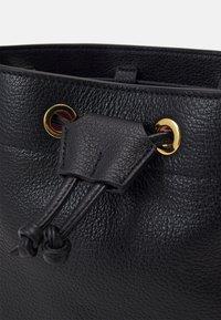Coccinelle - LEA BUCKET BAG - Across body bag - noir - 4